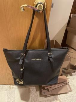 Michael Kors Large black Solid purse.